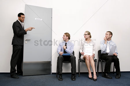 Sales person : Business people waiting for their turn to be interviewed