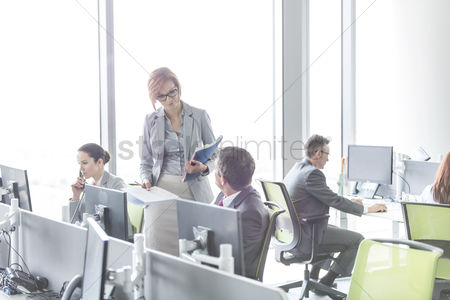 Furniture : Business people working in open plan office