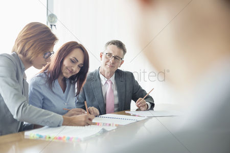 Women : Business people working together at conference table