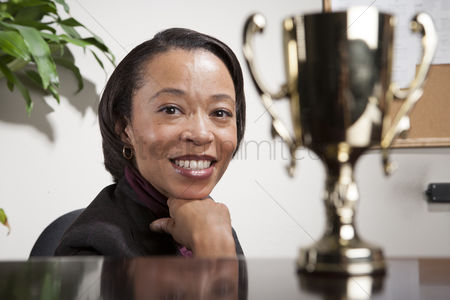 Proud : Business woman with award