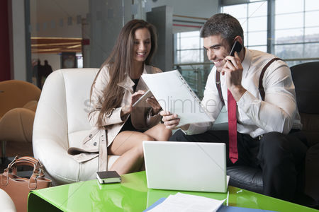 Czech republic : Businessman and businesswoman at meeting with laptop and tablet