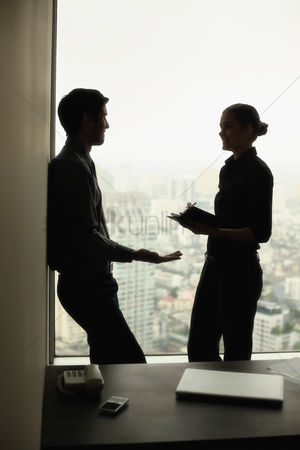 Leadership : Businessman and businesswoman having discussion