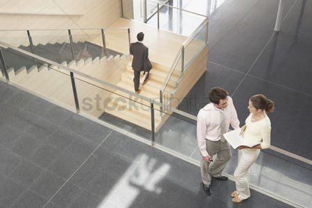 Steps : Businessman and businesswoman on office balcony