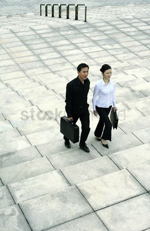 Steps : Businessman and businesswoman walking up the stairs