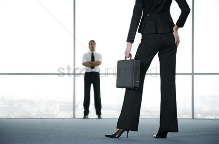 Conceptual : Businessman and businesswoman