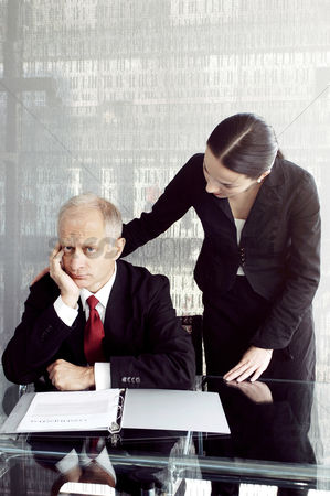 Sales person : Businessman being consoled by his secretary