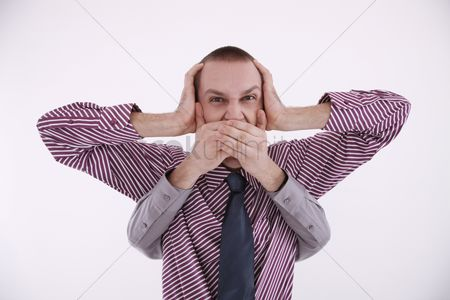 Ignorance : Businessman covering ears  a pair of hands covering his mouth