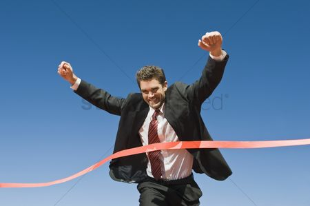 Business suit : Businessman crossing the winning line