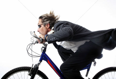 Outdoor : Businessman cycling at a fast speed