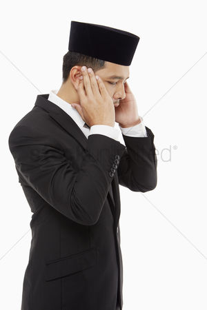God : Businessman doing the opening takbir and saying allahu akbar