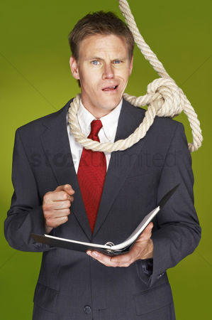 Rope : Businessman feeling uncomfortable with a rope hanging around his neck