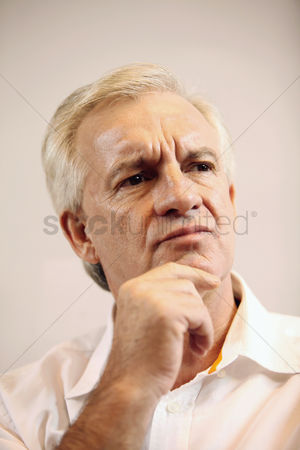 Frowning : Businessman having a deep thought