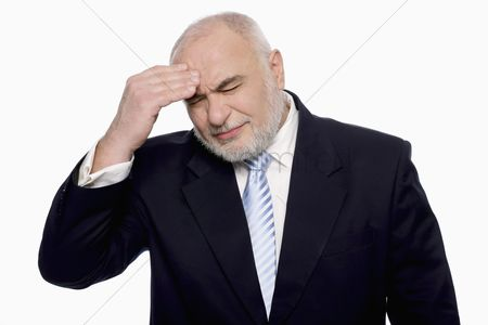 Color image : Businessman having headache