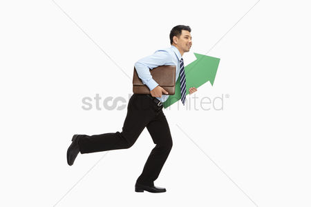 Masculinity : Businessman holding a briefcase and arrow  running