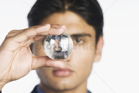 Corporation : Businessman holding a crystal ball