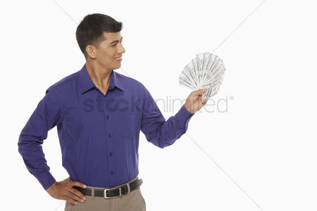 Masculinity : Businessman holding a lot of money