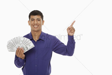 Asian : Businessman holding a lot of money
