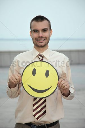 Cardboard cutout : Businessman holding happy expression mask