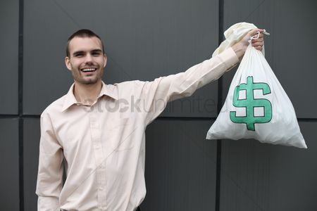 One man only : Businessman holding money bag
