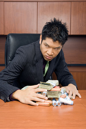Interior : Businessman holding money