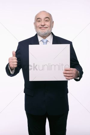 Respect : Businessman holding placard and showing thumbs up