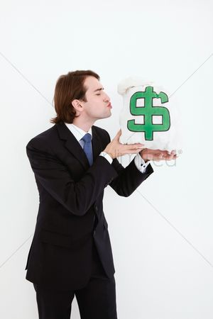 Kissing : Businessman kissing money bag