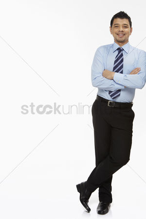 Masculinity : Businessman leaning against a wall