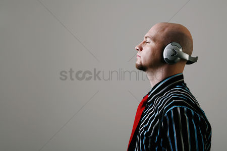 Relaxing : Businessman listening to music