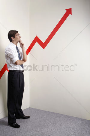 Thought : Businessman looking at a rocketing arrow sign