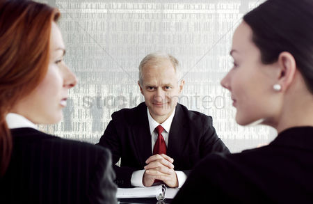 Thought : Businessman looking at two businesswomen