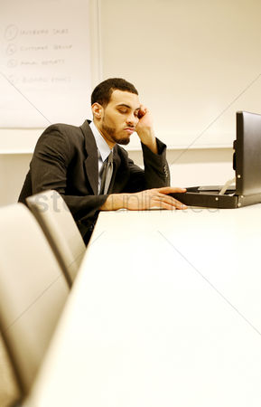 Corporation : Businessman looking bored