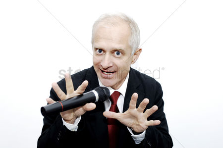 Determined : Businessman making a funny expression while singing