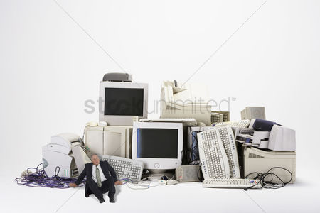 Guys : Businessman next to old computers