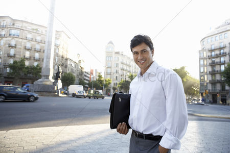 Pocket : Businessman on city street holding briefcase