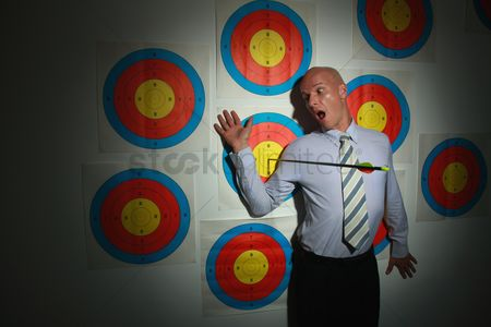 Bald : Businessman on target with arrow next to him