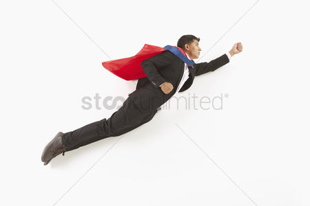 Asian : Businessman posing on the floor  flying