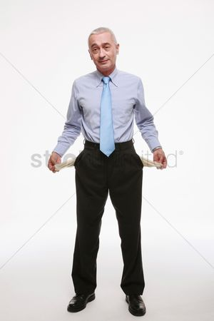 Pocket : Businessman pulling out empty pockets