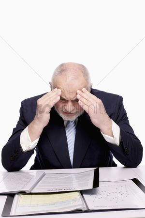 Pain : Businessman reading document with hands on head