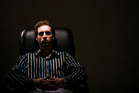 Leadership : Businessman relaxing on the chair