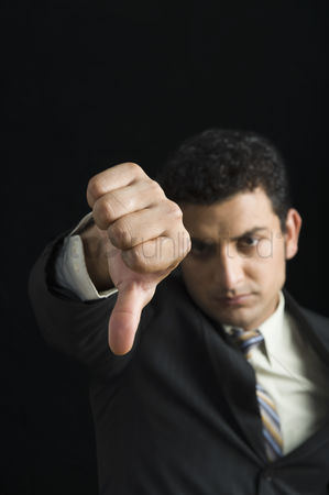 Forbidden : Businessman showing thumbs down sign