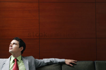 Relaxing : Businessman sitting on the couch thinking
