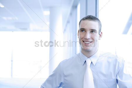 Appearance : Businessman smiling while thinking