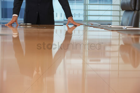 Leadership : Businessman standing at conference table