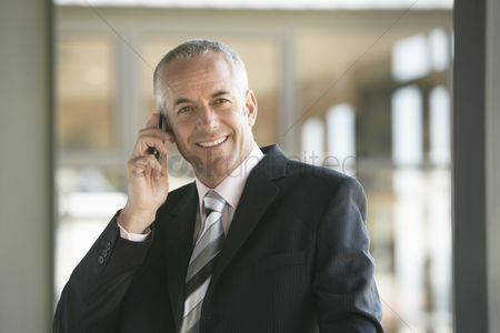 Business suit : Businessman using cell phone