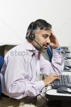 Earpiece : Businessman using telephone headset