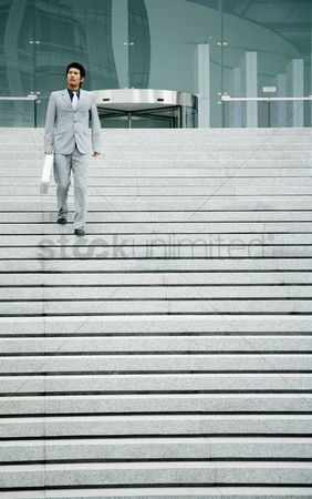 Stairs : Businessman walking down the stairs