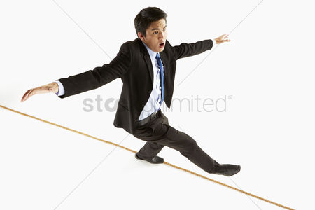 Masculinity : Businessman walking on a rope