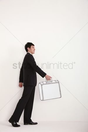 Cardboard cutout : Businessman walking with briefcase in hand