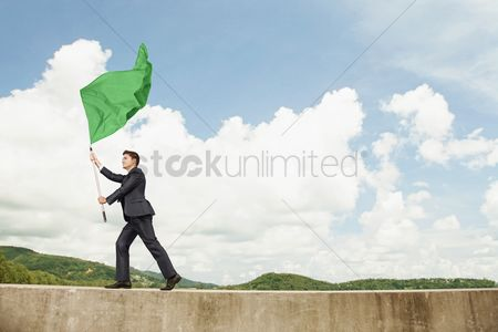 Respect : Businessman waving a green flag
