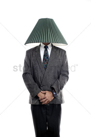 Funny : Businessman with a lamp shade covering his head